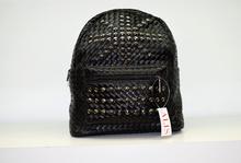 Дамска раница - ERIN - черна с капси и плетеници