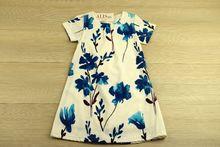 Бяла детска рокля със син мотив за 4 и 8 годишни